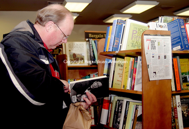 WOODBURY, CT -30 MARCH 2007 - Alan MacMillan of Simsbury looks over a book during a book fair at More Good Books in Woodbury Friday afternoon. A portion of the proceeds of any book purchased at the store will benefit the Grad Nite party for 2007 at Nonnewaug High School. Grad Nite is the all-night party at the high school that's held after graduation for the graduates. The store will be open today from 10 a.m. to 5 p.m. <br />  Darlene Douty/Republican-American