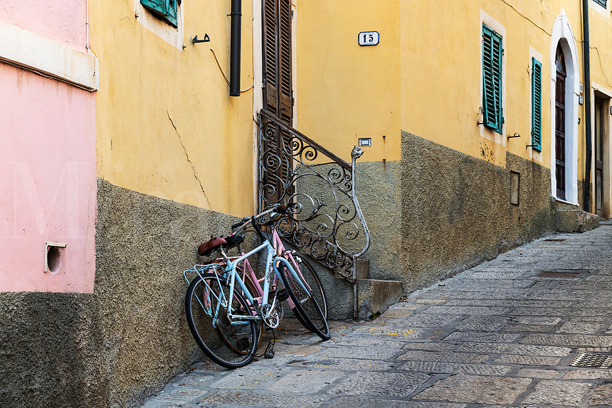 Bikes parked on a charming street, Porto Azzurro, Elba, Livorno, Italy.