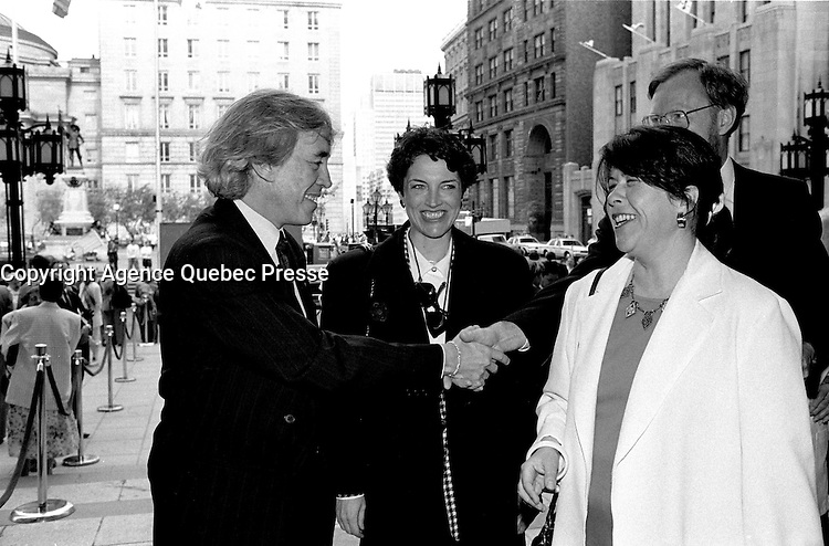 File Photo - Michel Petit and Louise Roy  attend<br /> Montreal 350th anniversary kick off celebrations, May 17, 1992, at Place-d-armes,<br /> <br />  Photo :  Agence Quebec Presse- Pierre Roussel