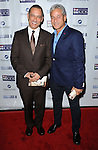 Greg Louganis and husband Johnny Louganis at the Mending Kids Gala Honoring Gene Simmons and family, held at the Santa Monica Airport Hanger 8 on November 9, 2013