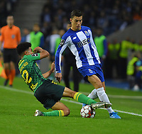 27th October 2019; Dragao Stadium, Porto, Portugal; Portuguese Championship 2019/2020, FC Porto versus Famalicao; Matheus Uribe of FC Porto slide tackled by Gustavo Assunção of Famalicao