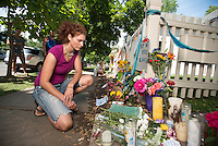 Rebecca Carlson (cq) looks at flowers and notes during a memorial for Robin Williams (cq) at the home where the hit television show Mork and Mindy took place in Boulder, Colorado, Wednesday, August 13, 2014. Williams, who rose to fame starring in Mork and Mindy, died at the age of 63 from an apparent suicide. <br /> <br /> Photo by Matt Nager