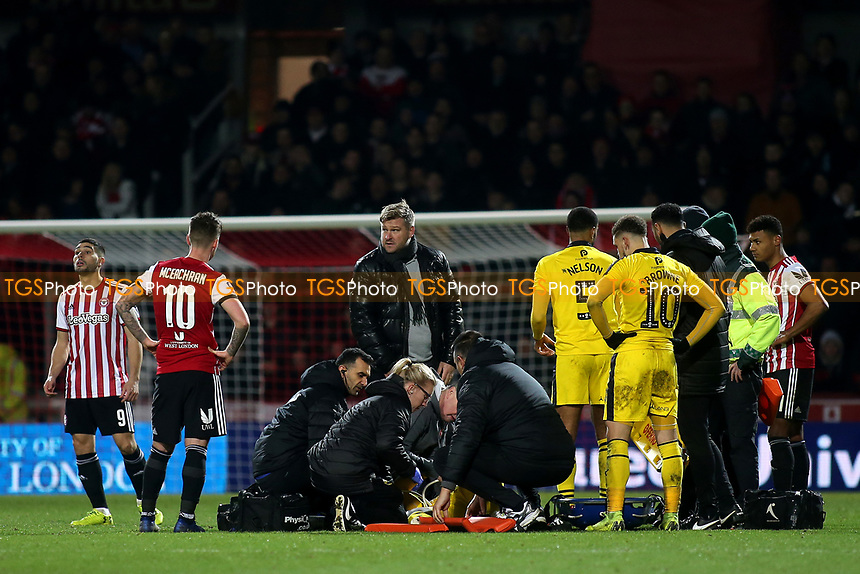 Oxford United Manager, Karl Robinson, comes onto the pitch to see the injured Shandon Baptiste of Oxford United who moments later was carried off on a stretcher during Brentford vs Oxford United, Emirates FA Cup Football at Griffin Park on 5th January 2019