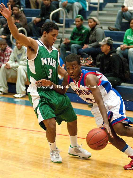 WATERBURY,  CT, 16 DECEMBER 2011-121611JS08-Crosby's Davon Robinson (2) drives to the basket past Wilby's Thomas King (3) during their game Friday at Crosby High School in Waterbury. <br />  Jim Shannon Republican-American