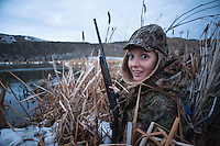Christine Marozick of Bozeman, Montana, duck hunts on the Missouri River near Toston.