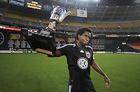 DC United midfielder Clyde Simms (19)  holds the Atlantic Cup that was earned after defeating the New York Red Bulls.  DC United defeated the New York Red Bulls 2-0, at RFK Stadium ,Thursday June 4, 2009.