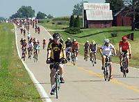 Riders make thier approach to Milo Wednesday on RAGBRAI XXXVII.