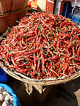 A basket of dried chillies for sale at Sylhet market.