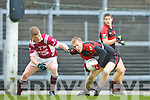 Kevin O'Sullivan Kenmare is pulled back by Batt Curtin Rockchapel during their Munster Club Champiionship semi final in Fitzgerald Stadlium on Sunday