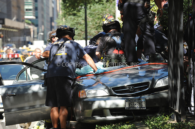 WWW.ACEPIXS.COM . . . . . ....September 3 2009, New York City....Injured parties are removed from the wreckage of a car after it crashed into the Central Reservation on Park Avenue around 48th Street on September 3 2009 in New York City....Please byline: KRISTIN CALLAHAN - ACEPIXS.COM.. . . . . . ..Ace Pictures, Inc:  ..tel: (212) 243 8787 or (646) 769 0430..e-mail: info@acepixs.com..web: http://www.acepixs.com