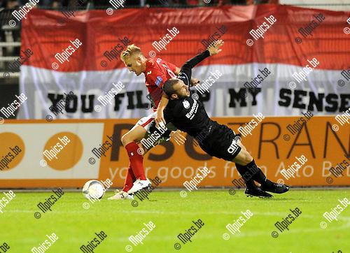2013-09-27 / Voetbal / seizoen 2013-2014 / R. Antwerp FC - Virton / Wil De Decker (l. Antwerp) met Yohan Croizet<br /><br />Foto: Mpics.be
