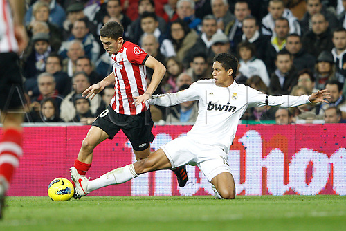 22.01.2012. Madrid Spain. La Liga  The match played between  Real Madrid and Athletic Club de Bilbao (4-1)  played at the Santiago Bernabeu Stadium.  Picture show Oscar de Marcos Arana (Spanish forward of Athletic) and Raphael Varane (French defender of Real Madrid)