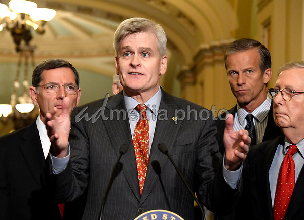 United States Senator Bill Cassidy (Republican of Louisiana) speaks to reporters outside the US Senate Chamber following the Republican weekly luncheon caucus in the US Capitol in Washington, DC on Tuesday, September 19, 2017.  The GOP leadership is advocating for the passage of the Graham-Cassidy Act that would replace parts of the Affordable Care Act (also known as ObamaCare) with block grants for the individual states.  From left to right: US Senator John Barrasso (Republican of Wyoming), Senator Cassidy, US Senator John Thune (Republican of South Dakota), and US Senate Majority Leader Mitch McConnell (Republican of Kentucky). Photo Credit: Ron Sachs/CNP/AdMedia