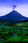Arenal Volcano At Dawn Erupting Smoke And Ash In Costa Rica.