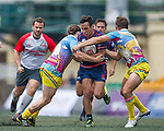Taikoo Place Scottish Exiles (in dark blue) defeat XBlades Rowzy Pegasi (in yellow and blue) 27 to 0 during Day 1 (Pool B) of GFI HKFC Rugby Tens 2016 on 06 April 2016 at Hong Kong Football Club in Hong Kong, China. Photo by Juan Manuel Serrano / Power Sport Images