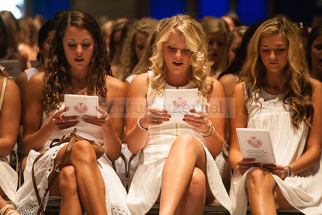 Soon-to-be sorority women sing during UK's sorority bid day in Lexington, Ky., on Friday, August 22, 2014. Photo by Adam Pennavaria | Staff