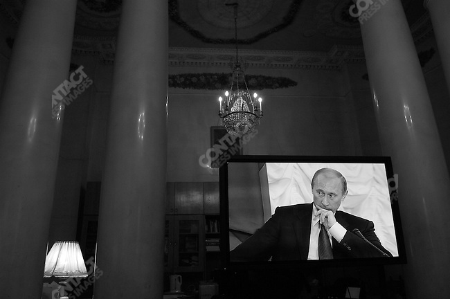 A screen showed President Vladimir Putin of Russia, who was speaking in the next door room, to the Council of the Russian Academy of Sciences two days before the country goes to the polls for parliamentary elections. Moscow, Russia, November 30, 2007