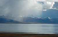 Tibet Landscapes and aerials Lake Namtso which is the highest saltwater lake in the world at an elevation of 4870 meters. The snow-covered Mountain range just behind the lake reach over 7500 meters.
