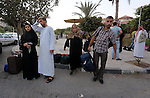 Families of Palestinian martyrs gather at al-Katiba square before travel to Saudi Arabia through Egypt to attend the annual Hajj, in Gaza city on September 17, 2015. Custodian of the Two Holy Mosques King Salman has issued orders to host 1,000 Palestinians from martyrs' families to perform Haj this year. According to the Muslims holy book the Koran, the Kaaba was built by Abraham and his son Ismael, after Ismael had settled in Arabia. Millions of Muslims have arrived in Saudi Arabia to perform their Haj. Photo by Mohammed Asad