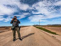 Luis Gutiérrez, photographer in the road landscape of the Sonora road. blue sky.<br /> <br /> Luis Gutierrex, fotogradfo en paisaje de carretera de terraceria de Sonora. cielo azul.<br /> <br /> (Photo: Luis Gutierrez / NortePhoto.com)