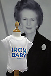 © Joel Goodman - 07973 332324 . No syndication permitted . 30/09/2013 . Manchester , UK . Margaret Thatcher Iron Baby wear . Products for sale in the exhibition this morning (Monday 30th September 2013) . Day 2 of the Conservative Party Conference 2013 at Manchester Central . Photo credit : Joel Goodman