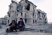 Two arm Mudjahedins in charge of the Darulaman King Palace, South of Kabul..The continuing attack (1992 to 1995) from warlord Ahmad Shah Massoud of the Jamiat-e Islami and warlord Abdul Rassoul Sayyaf from the Islamic Union for the Liberation of Afghanistan, against Mujahedin leader Abdul Ali Mazari of Hezb-e-Wahdat Islami and is people, destroy one third of the Afghan capital and murdered more of 4000 civilians.