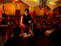 Buddhist Monks in a Losar ceremony inside a monastery, Sikkim, India