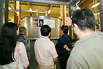 Members of the press look at the interior of Katsuyama Supreme SAKE Co., Ltd. as part of the ''1000km Relay to Tokyo 2016'' promotion event in Sendai City on July 30, 2016, Miyagi, Japan. The sake brewery factory received the Gold Medal of Junmai Ginjo category at the International Wine Challenge 2016 Award for its flagship sake ''Akatsuki'' on July 29, 2016. The sake brewery was established over 320 years ago and is expanding to market their products overseas. (Photo by Rodrigo Reyes Marin/AFLO)