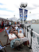 Old Age Pensioners on deckchairs on Brighton Pier, United Kingdom