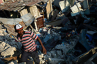 Port Au Prince, Haiti, Jan 24 2010.Michel Watson, a motorbike taxi driver lost everything in the catastrophe; the Fort National neighborhood of Port au Prince has been reduced to rubble..