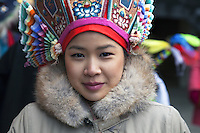 Switzerland. Basel. St. Jakobshalle. A young tibetan teenager girl dressed in traditional clothings waits for the arrival of His Holiness the Dalai Lama. 7.02.2015 © 2015 Didier Ruef