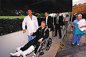 United States President Bill Clinton is wheeled out of St. Mary's Hospital in West Palm Beach, Florida after receiving treatment for a leg injury on March 14, 1997.  The President will undergo surgery for a torn tendon in his right knee after stumbling on steps at the Florida home of golf pro Greg Norman.<br /> Mandatory Credit: Robert McNeely / White House via CNP