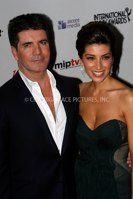 WWW.ACEPIXS.COM . . . . .  ....November 22 2010, New York City....Simon Cowell and Mezhgan Hussainy arriving at the 38th International Emmy Awards at the New York Hilton and Towers on November 22, 2010 in New York City. ....Please byline: NANCY RIVERA- ACEPIXS.COM.... *** ***..Ace Pictures, Inc:  ..Tel: 646 769 0430..e-mail: info@acepixs.com..web: http://www.acepixs.com