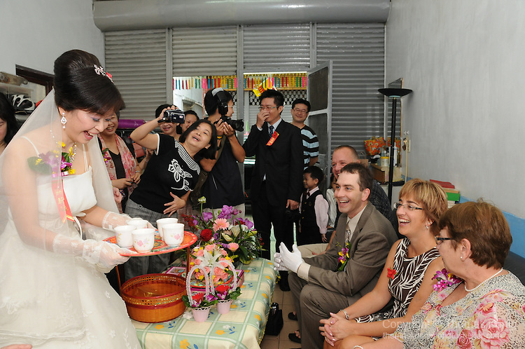 Taiwanese Wedding -- The bride treats the family of the groom to a traditional cup of tea.