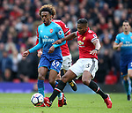Joe Willock  of Arsenal tackled by Luis Antonio Valencia of Manchester United during the premier league match at the Old Trafford Stadium, Manchester. Picture date 29th April 2018. Picture credit should read: Simon Bellis/Sportimage
