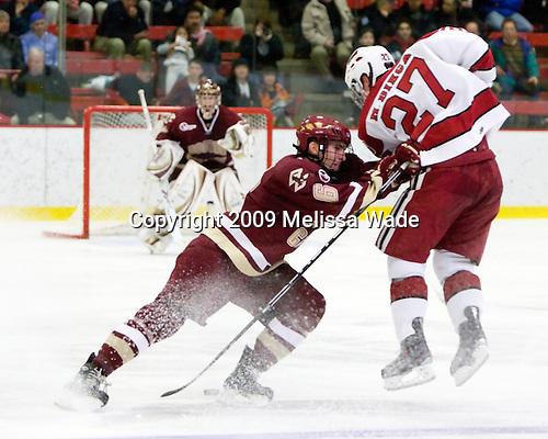 Patrick Wey (BC - 6), Michael Biega (Harvard - 27) - The Boston College Eagles defeated the Harvard University Crimson 3-2 on Wednesday, December 9, 2009, at Bright Hockey Center in Cambridge, Massachusetts.
