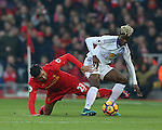 Didier Ndong of Sunderland tackled by Emre Can of Liverpool during the Premier League match at the Anfield Stadium, Liverpool. Picture date: November 26th, 2016. Pic Simon Bellis/Sportimage