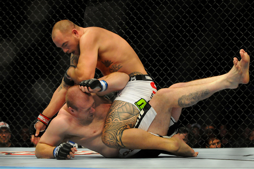 24 SEPTEMBER 2011:  Travis Browne lands an elbow on Rob Broughton   during UFC 135 at the Pepsi Center in Denver, Colorado. *****For Editorial Use Only*****