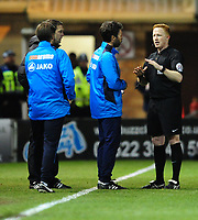 Referee Alan Young, right, speak to Lincoln City manager Danny Cowley, centre, and Lincoln City's assistant manager Nicky Cowley<br /> <br /> Photographer Chris Vaughan/CameraSport<br /> <br /> Vanarama National League - Lincoln City v Chester - Tuesday 11th April 2017 - Sincil Bank - Lincoln<br /> <br /> World Copyright &copy; 2017 CameraSport. All rights reserved. 43 Linden Ave. Countesthorpe. Leicester. England. LE8 5PG - Tel: +44 (0) 116 277 4147 - admin@camerasport.com - www.camerasport.com