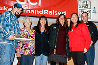 The Northern Air Cargo Herbie Nayokpuk Memorial Award is presented by Ross St. John, outside sales manager, and Cheryl Johnson, director of community relations for Northern Air Cargo as well as members of the Nayokpuk family including Herbie's widow Elizabeth to Michelle Phillips<br />  at the Nome Musher's Award Banquet during the 2017 Iditarod on Sunday March 19, 2017.<br /> <br /> Photo by Jeff Schultz/SchultzPhoto.com  (C) 2017  ALL RIGHTS RESERVED