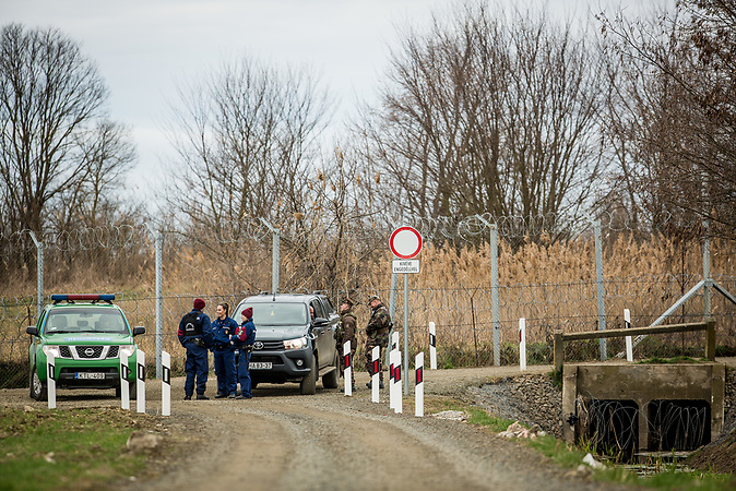 The border fence and hungarian police and border guards near the village of Röszke, Hungary.