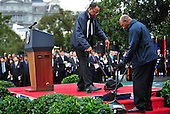 White House staff clean the podium area prior to an arrival ceremony for President Lee Myung-bak of South Korea on the South Lawn at the White House in Washington, D.C. on Thursday, October 13, 2011.  .Credit: Kevin Dietsch / Pool via CNP