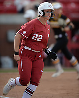 NWA Democrat-Gazette/ANDY SHUPE<br /> Arkansas' Linnie Malkin rounds first base after hitting a 2-run double against Wichita State Wednesday, April 10, 2019, during the sixth inning at Bogle Park in Fayetteville. Visit nwadg.com/photos to see more photographs from the game.