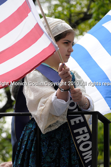 Greek Parade in New York City. A girl in costume and holding a flag in the Greek Parade in New York City.