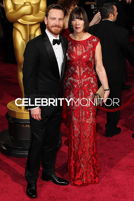 HOLLYWOOD, CA, USA - MARCH 02: Michael Fassbender, Adele Fassbender at the 86th Annual Academy Awards held at Dolby Theatre on March 2, 2014 in Hollywood, Los Angeles, California, United States. (Photo by Xavier Collin/Celebrity Monitor)