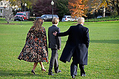 United States President Donald J. Trump, right, accompanied by first lady Melania Trump, left, and son Barron Trump, center, walks to Marine One on the South Lawn of the White House in Washington, DC prior to their departure for Mar-A-Lago, where he will spend the Thanksgiving holiday, on Tuesday, November 21, 2017.<br /> Credit: Ron Sachs / CNP