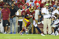 Landover, MD - August 24, 2018: Washington Redskins wide receiver Paul Richardson (10) tries to break a tackle during the preseason game between Denver Broncos and Washington Redskins at FedEx Field in Landover, MD.   (Photo by Elliott Brown/Media Images International)