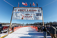 Race banner at the start line of the Restart of the 2016 Iditarod in Willow, Alaska.  March 06, 2016.
