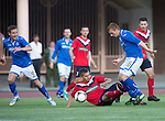 St Johnstone v FC Minsk...01.08.13 Europa League Qualifier at Neman Stadium, Grodno, Belarus...<br /> Liam Caddis gets fouled by Aliaksandr Sachyuka<br /> Picture by Graeme Hart.<br /> Copyright Perthshire Picture Agency<br /> Tel: 01738 623350  Mobile: 07990 594431