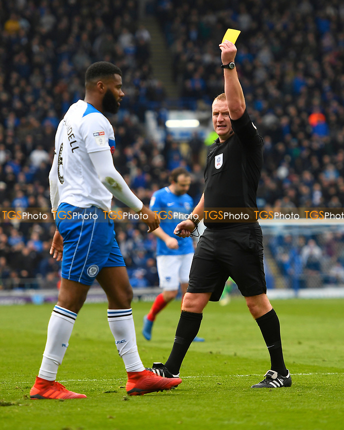 Ethan Ebanks-Landell of Rochdale is given a yellow card for tripping Nathan Thompson of Portsmouth in the penalty area  during Portsmouth vs Rochdale, Sky Bet EFL League 1 Football at Fratton Park on 13th April 2019